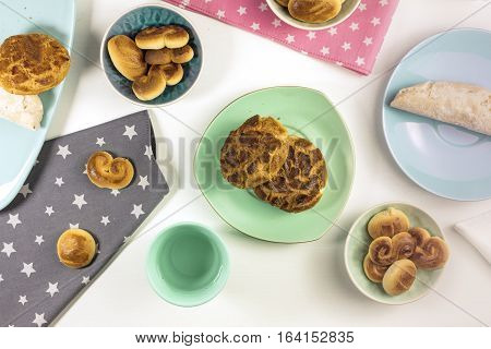 An overhead photo of traditional Madrid biscuits: pastas del consejo, rosquillas and azucarillos