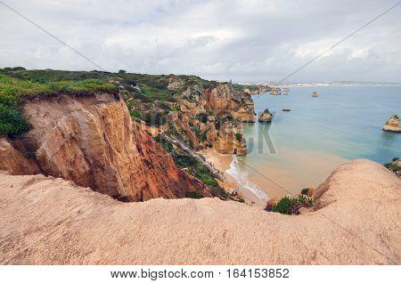 El Algarve coastline on a cloudy day Algarve Portugal.