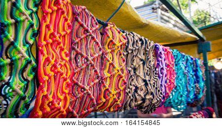 Row of colorful fabric at Feria de Mataderos