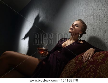 Young Woman And The Culprit's Shadow On The Wall