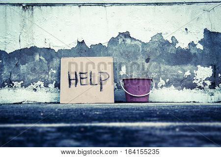 Help sign paper on the grungy wall,poverty concept and ideas