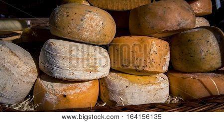 wheels of cheese at the Feria de Mataderos