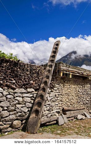 Old ledder on the old house in mountains, Nepal