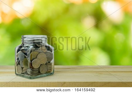 Money saving in the glass bottle for money concept