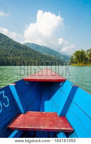 Boat ride across tropical river. Lake Phewa at Pokhara in Nepal.