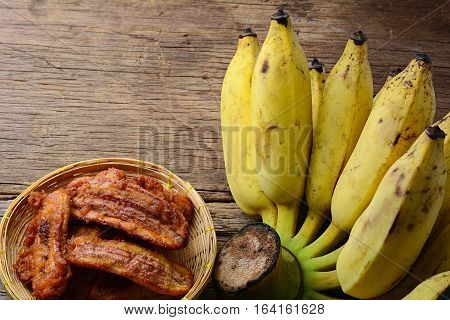 deep-fried sliced banana on old wooden table