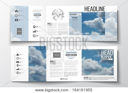 Set of tri-fold brochures, square design templates with element of world globe. Beautiful blue sky, abstract background with white clouds, leaflet cover, business layout, vector illustration