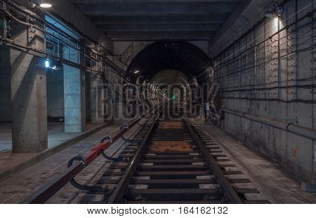 Underground tunnel. Railway in a subway tunnel