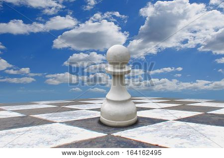 White pawn on chess board on white background
