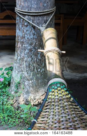 Handmade bamboo hammock craft weave in the garden stock photo