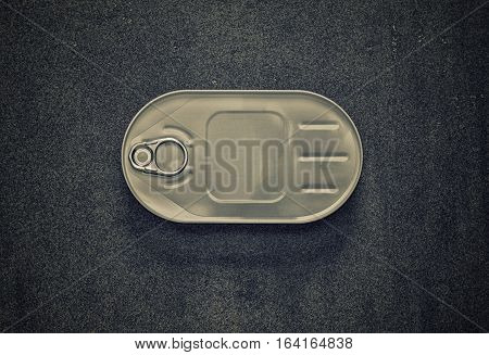 closed cans in the oval package on a gray background top view