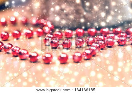 Red garlands on a wooden table. New Year