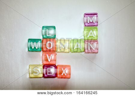many-colored words MAN,LOVE,WOMAN of plastic cubics and white chars