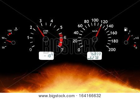 Car panel dashboard on fire. Tachometer and speedometer