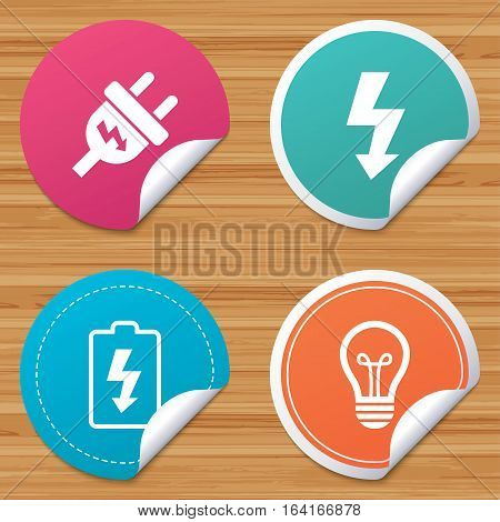 Round stickers or website banners. Electric plug icon. Lamp bulb and battery symbols. Low electricity and idea signs. Circle badges with bended corner. Vector