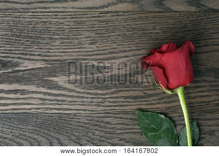 romantic background with red rose on wood table from above, with copy space