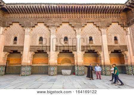 Marrakesh Morocco - December 8 2016: Inside the five century old school or Ali ben Youssef Medersa in the center of Marrakesh. The Ben Youssef Madrasa was an Islamic college in Marrakesh Morocco.