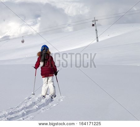 Girl On Skis In Off-piste Slope With New Fallen Snow At Nice Day