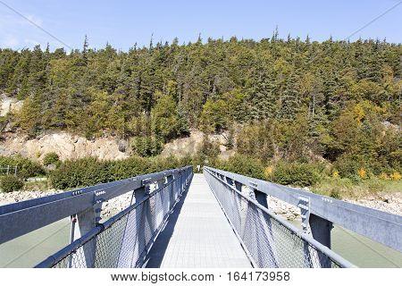 The metal narrow bridge over Skagway River in Skagway town.