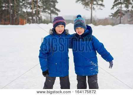 Two Skater Brothers On The Ice