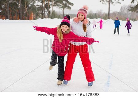 Two Attractive Skater Girls On The Ice