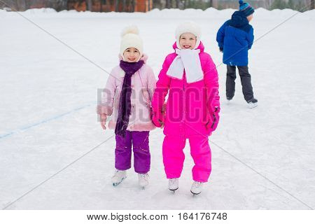 Two Young Skater Girls On The Ice