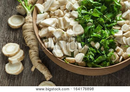 chopped vegetables in bowl on old wooden table