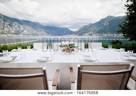 table coverage in open air restaurant terrace with picturesque view.