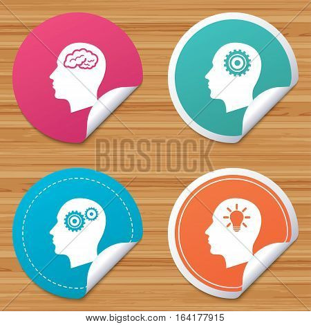 Round stickers or website banners. Head with brain and idea lamp bulb icons. Male human think symbols. Cogwheel gears signs. Circle badges with bended corner. Vector