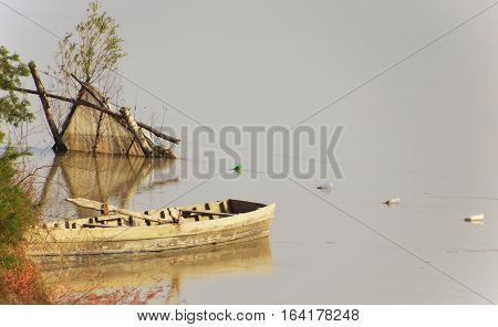 Old poaching boat on the river coast
