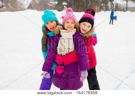 Three Attractive Skater Girl Hug On The Ice