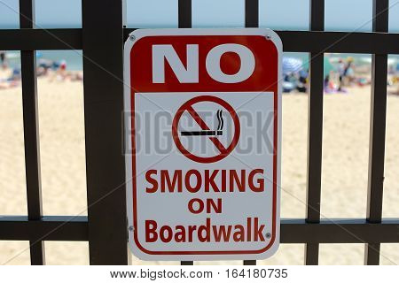 No smoking on boardwalk sign outside on beach in summertime