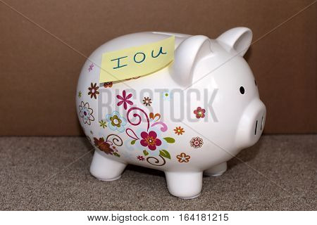 piggy bank with post it saying i o u on it