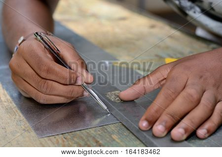 Craftsman working in workshop with scribing needle poster