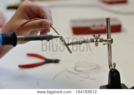 Tradesman when soldering electronic parts - closeup