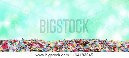 Colorful round confetti with brilliant green background