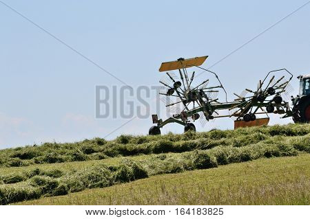 Two-wheeled swather at the hay harvest in use - Nauhaufnahme