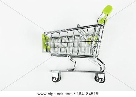 Metal shopping trolley. Empty cart. Macro shot.