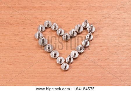 Heart laid out from a metal screw for fastening structures