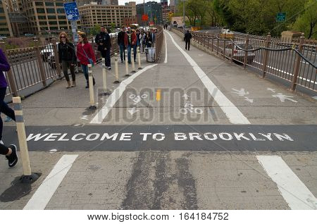 NEW YORK - APRIL 29 2016: welcome to brooklyn sign on the brooklyn bridge walkway. It connects the New York City boroughs of Manhattan and Brooklyn and crosses the East river