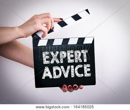 Expert Advice. Female hands holding movie clapper.