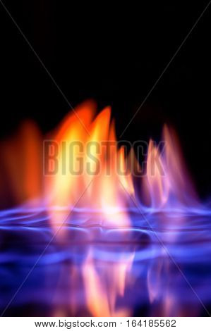 Blue and yellow colored flames isolated on black background