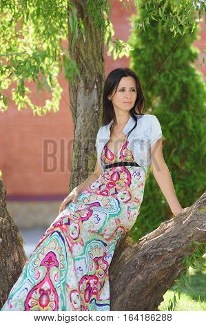 Beautiful girl of Slavic appearance sitting in the Park