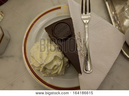 VIENNA, AUSTRIA - JANUARY 2 2016: The original Sacher Torte served with whipped cream at Hotel Sacher Hotel in Vienna