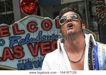 Sao Paulo Brazil March 6 2016: An unidentified street singer at Paulista Avenue dressed like Elvis Presley in Sao Paulo Brazil.