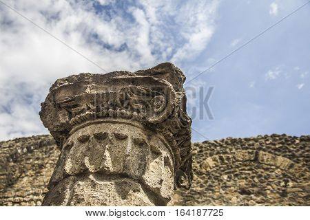 Ancient column, Corinthian order in Pompeii  city destroyed in 79BC by the eruption of Mount Vesuvius. The antique ruins and the vulcano near Naples, Italy