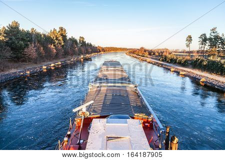 inland vessel drives a canal river along