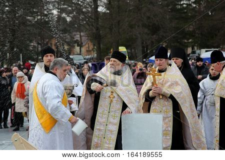 Priest Consecrates The Ice Hole On Epiphany Day