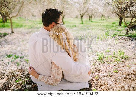 Wedding Couple Embrace Under The Tree