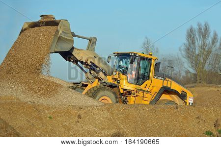 LITTLE PAXTON, CAMBRIDGESHIRE, ENGLAND -  JANUARY 05, 2017: JCB working in gravel yard.